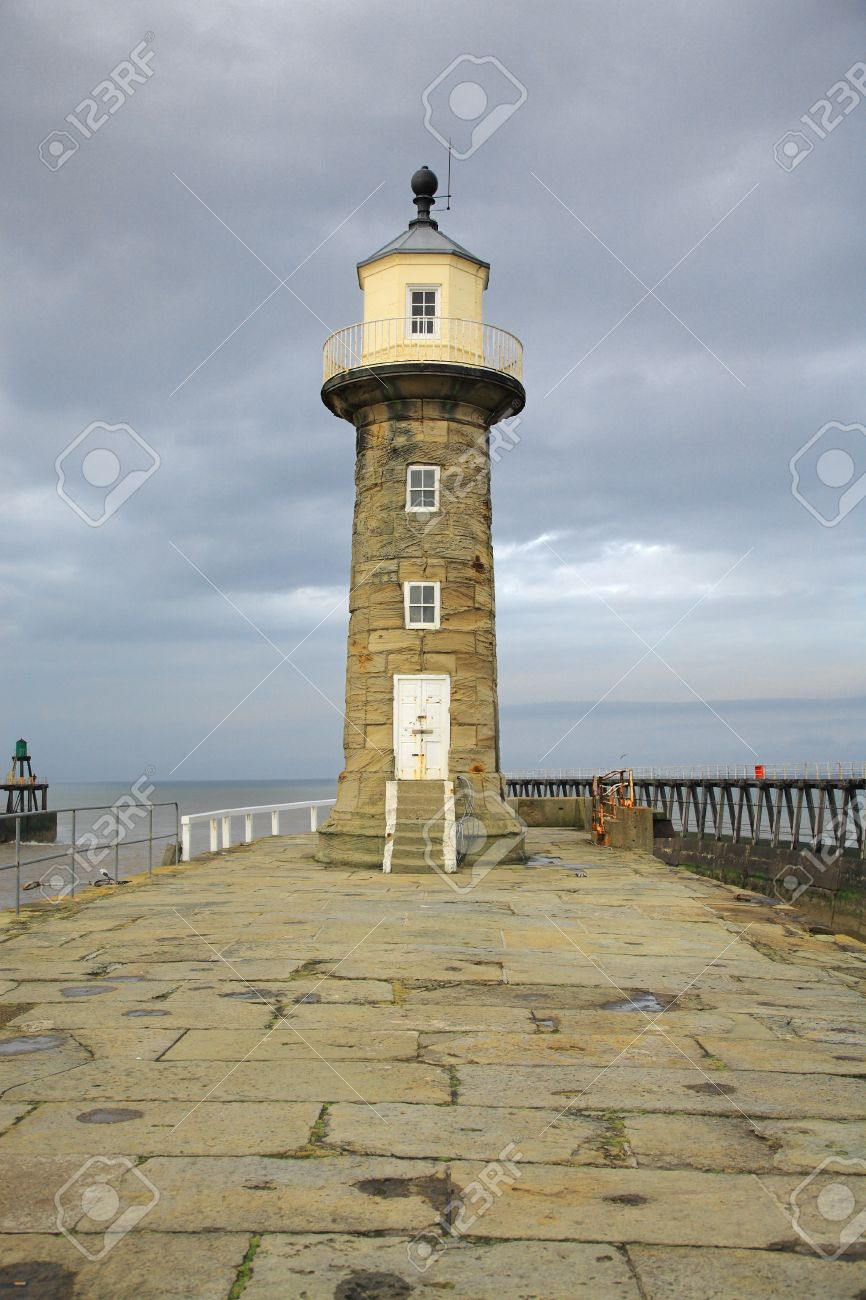 Whitby Lighthouse against a dramatic sky North Yorkshire England - 4025036