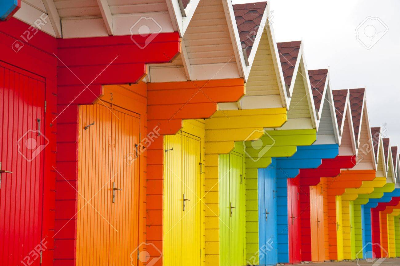 A colourful row of wooden beach huts. - 16649054
