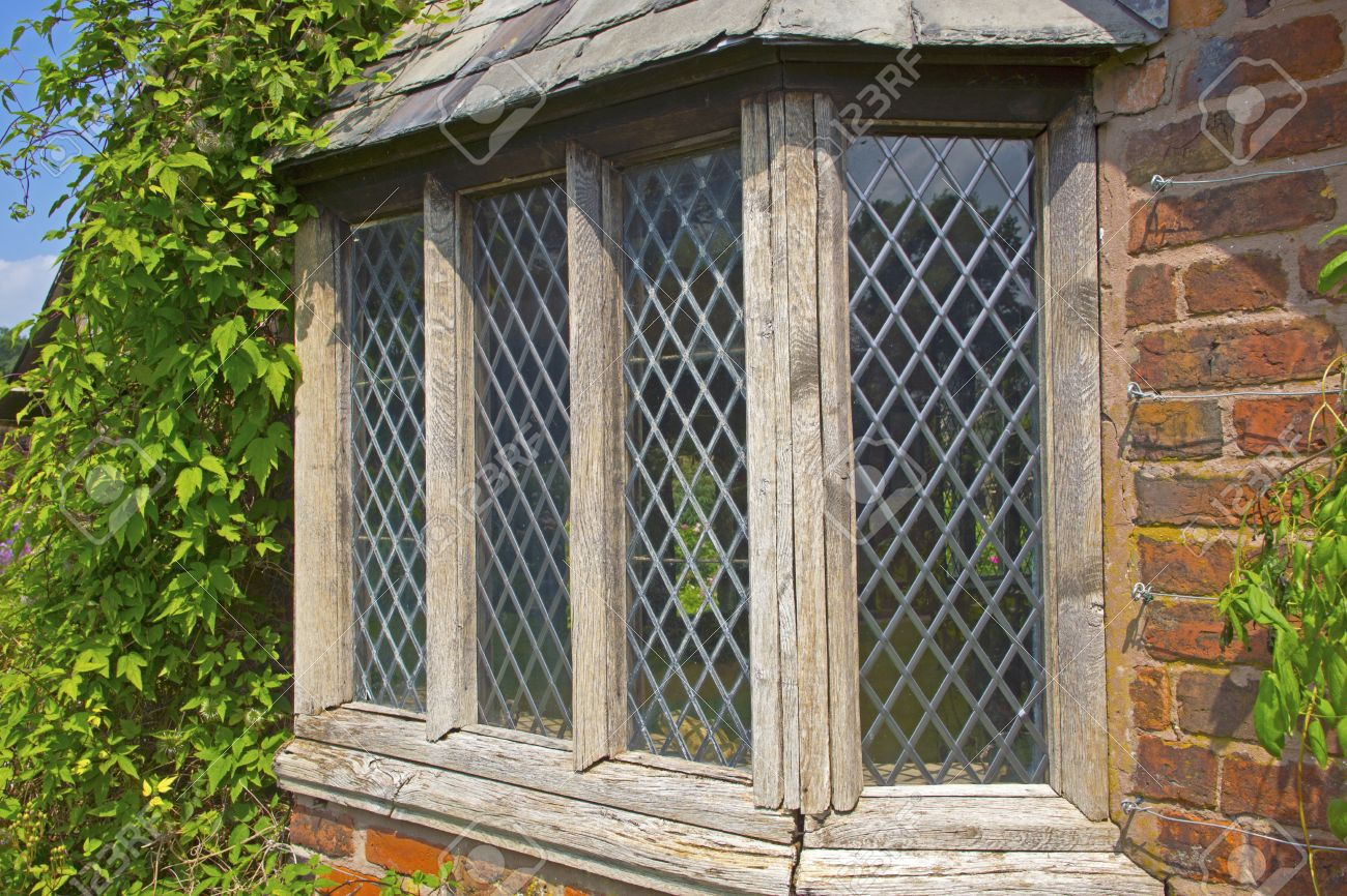 Old garden house - Old Weathered Window Of A Garden House With Leaded Glass Panes Stock Photo 22082848