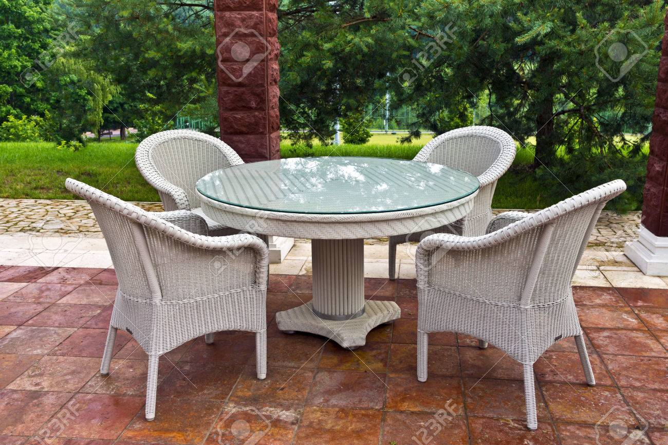 White table and chairs patio furniture in a garden s gazibo - 30684727