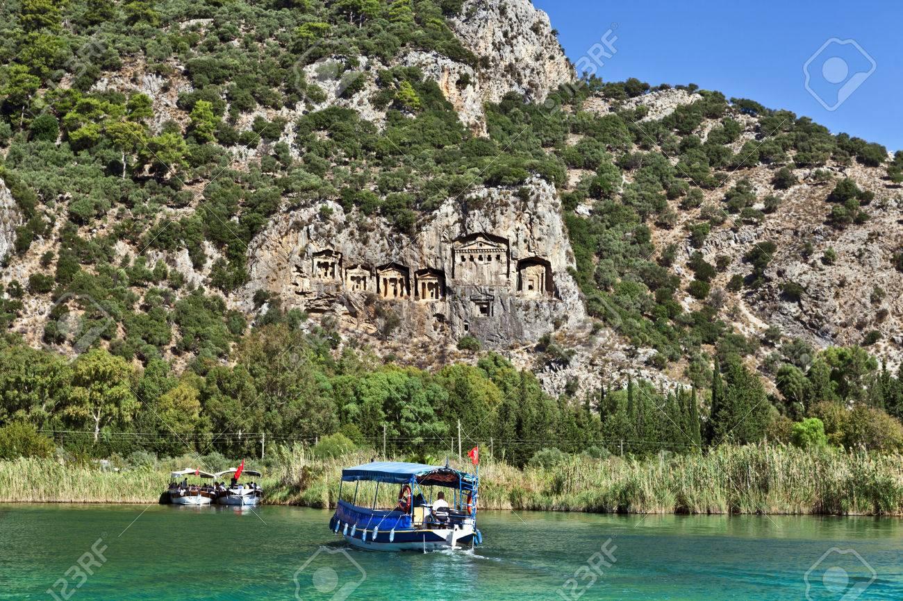 Tourist boats by the historic Kaunian rock tombs in Dalyan, Ortaca, TURKEY. - 32571372