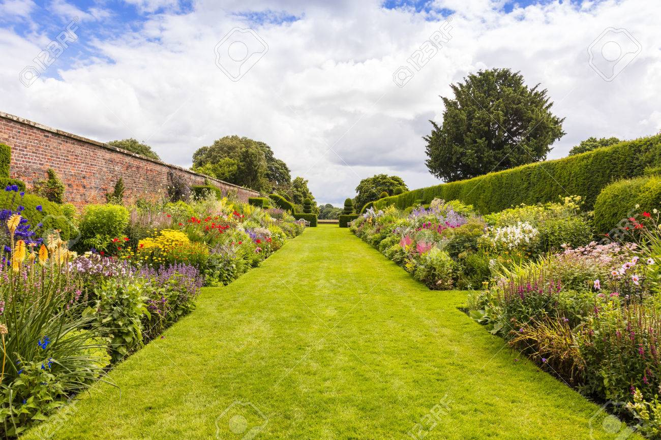 Herbaceous Border In A Well Tended Garden With Perennial Flowering.. Stock  Photo, Picture And Royalty Free Image. Image 71930483.