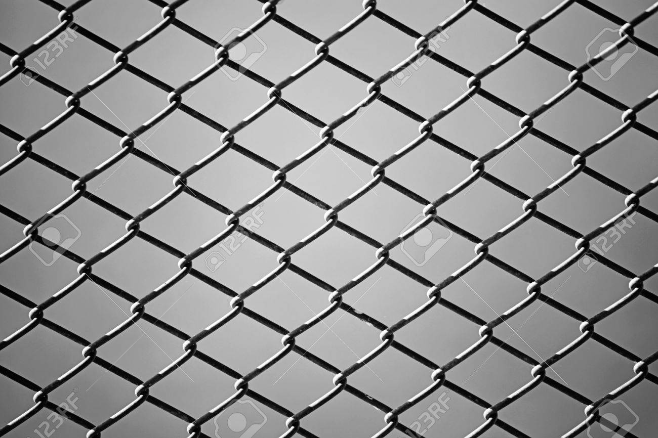 Close Up Of Wire Fence In Black And White. Background Stock Photo ...