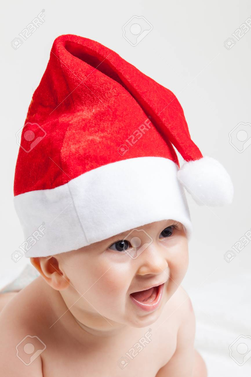 1fa3508e5ca Cute Baby With Christmas Cap Stock Photo