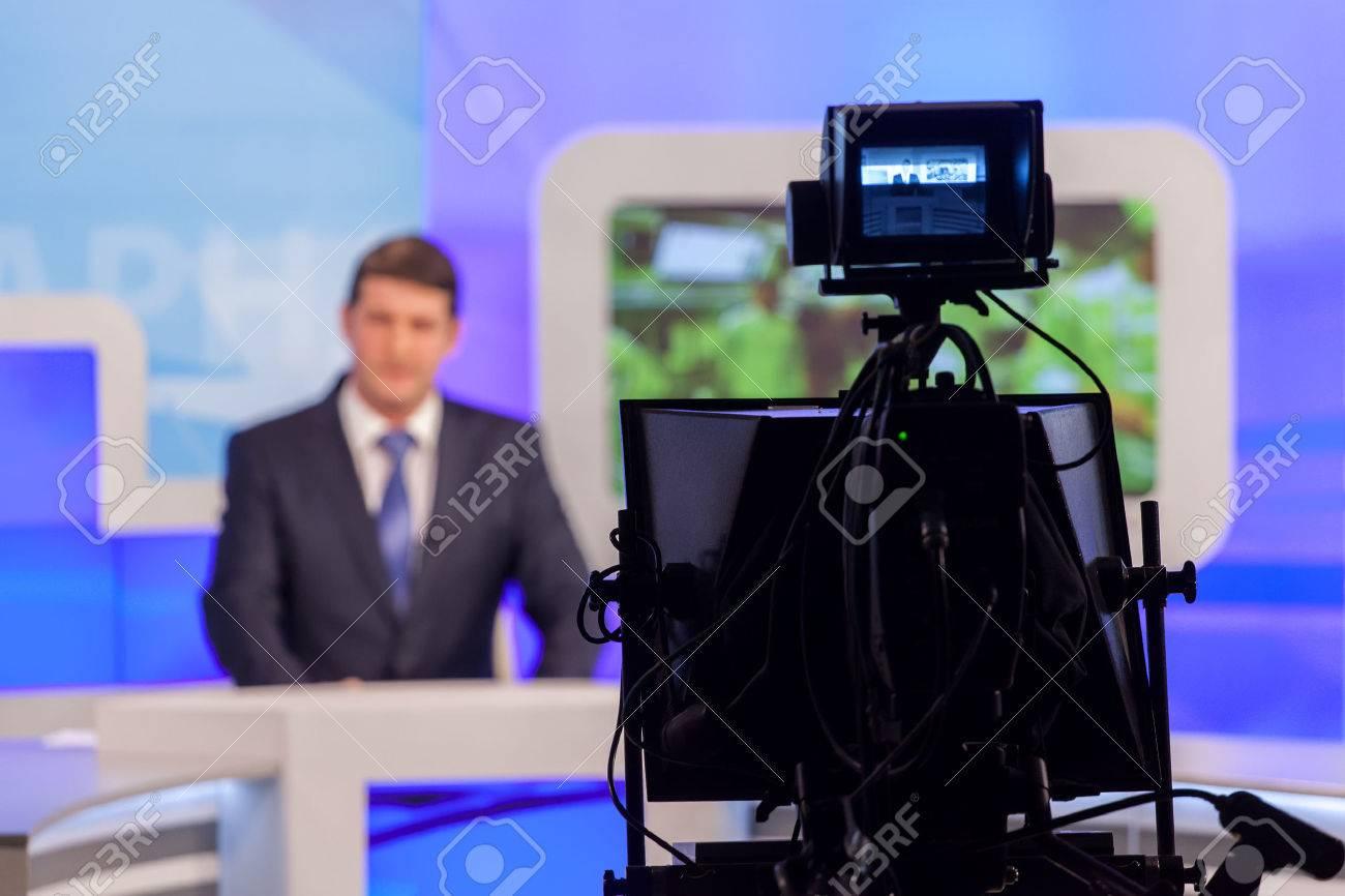 tv studio camera recording male reporter or anchorman. Live broadcasting - 56967030