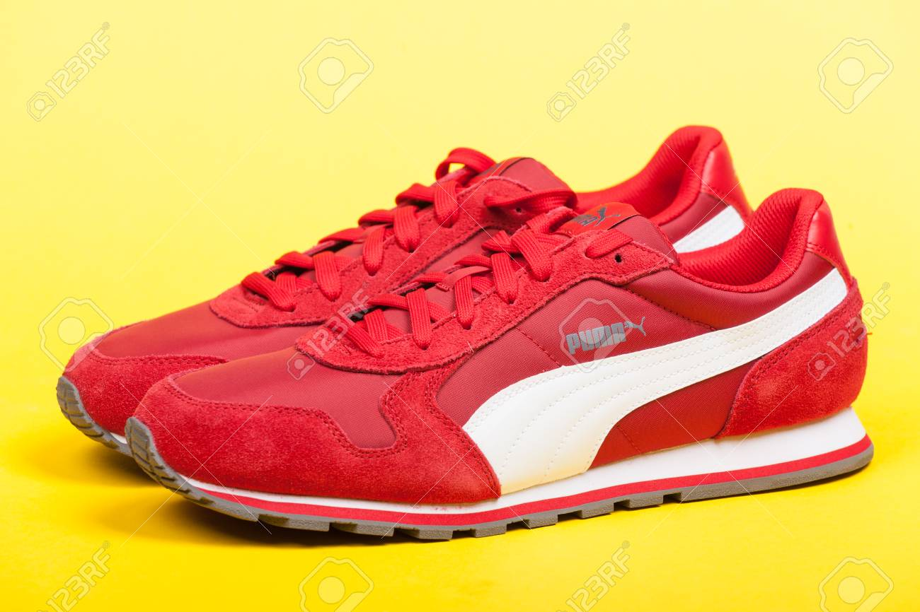 new style dbf05 d6e99 Varna , Bulgaria - JUNE 17, 2017. Red PUMA sport shoes on yellow..