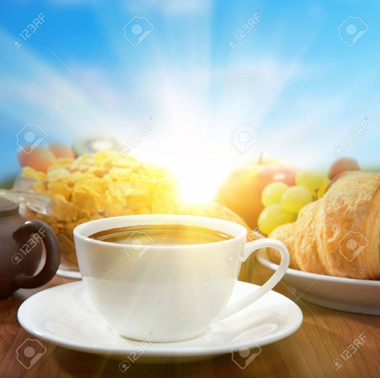 sunny breakfast with coffee and fruits Stock Photo - 19108757