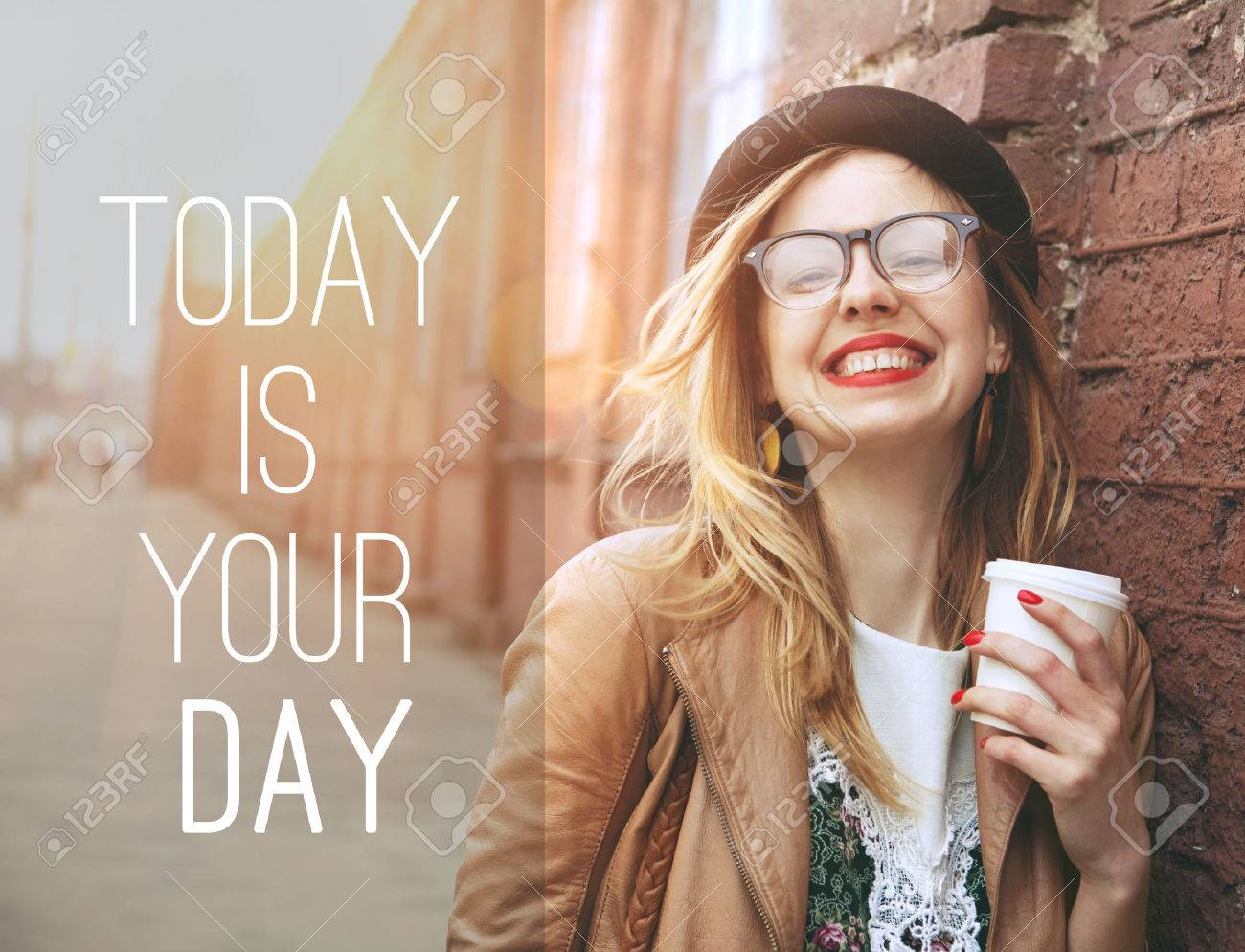 Woman in the street drinking morning coffee in sunshine light with motivational text Stock Photo - 46656423