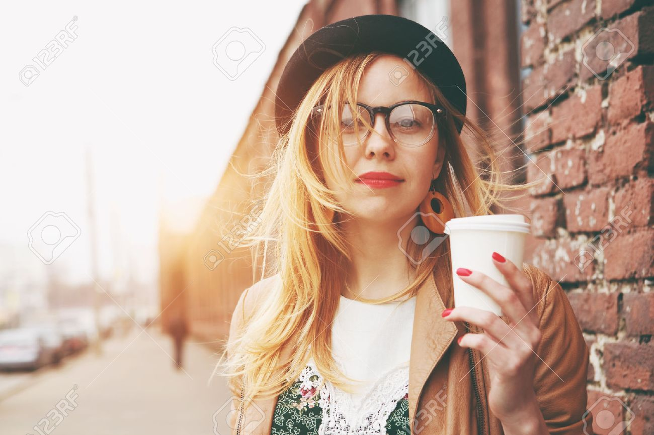 Stylish woman in the street drinking morning coffee Stock Photo - 46656425