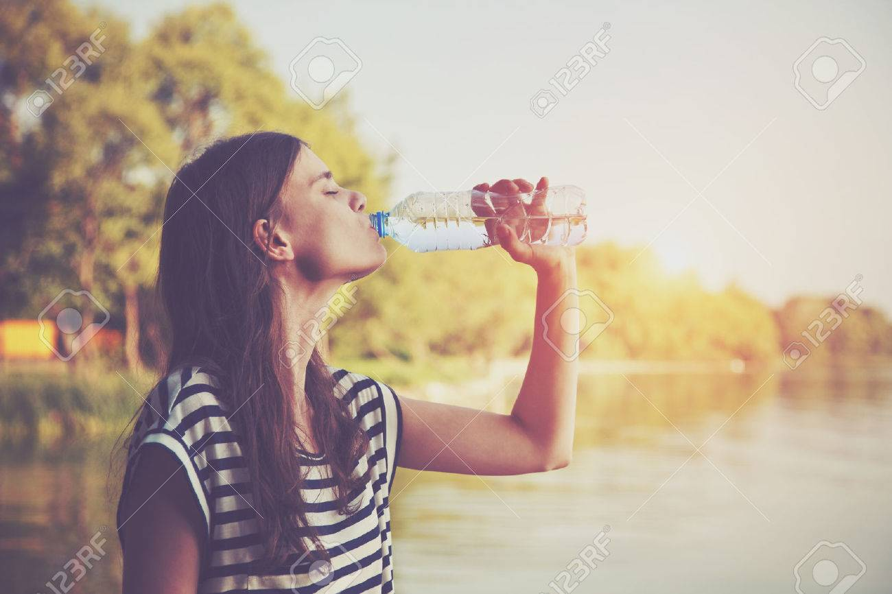 Woman drinking water Stock Photo - 46616534