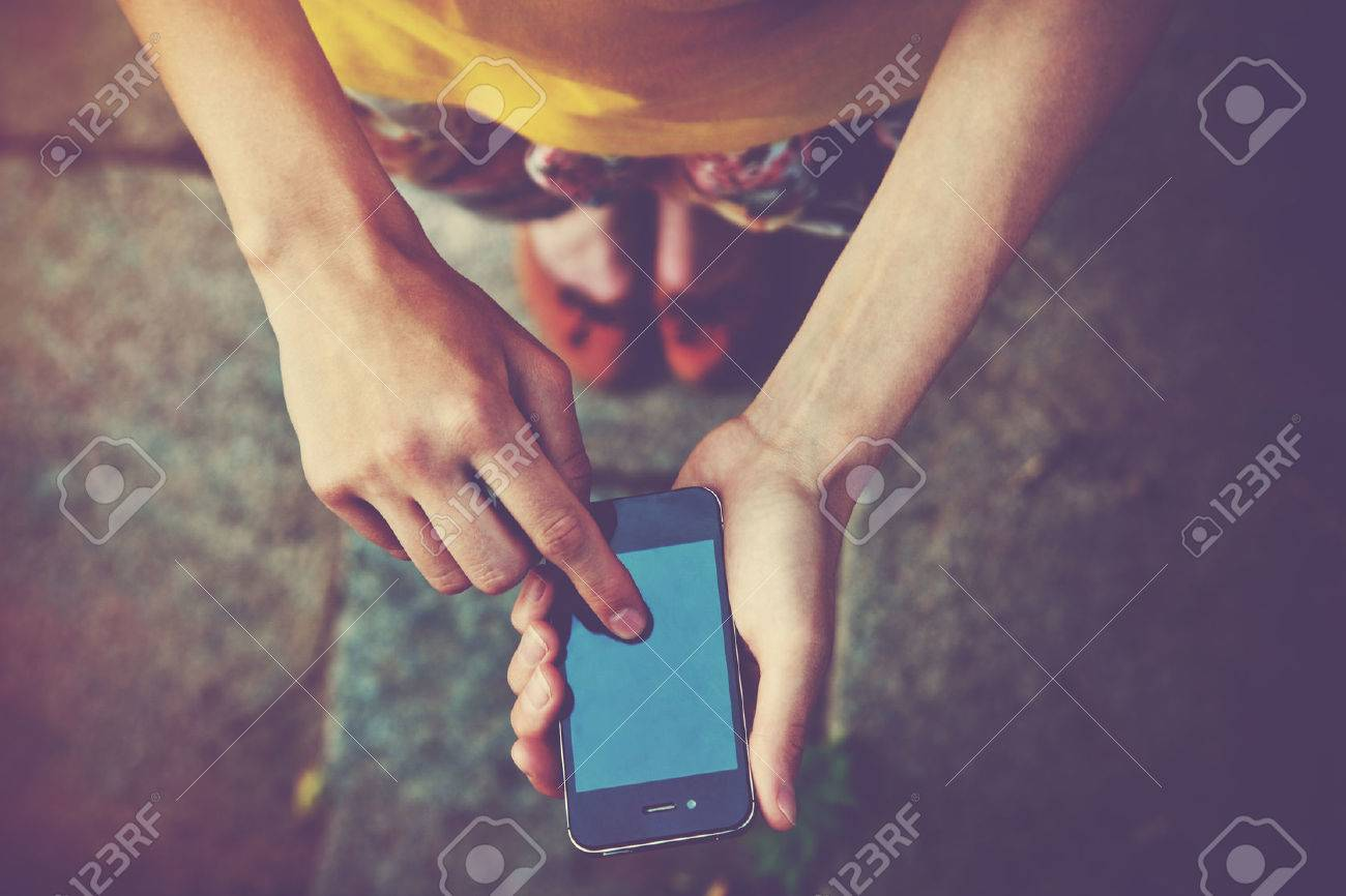 hands using a phone texting on smartphone app Stock Photo - 46651292