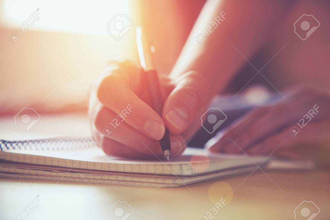 female hands with pen writing on notebook Stock Photo - 46651061