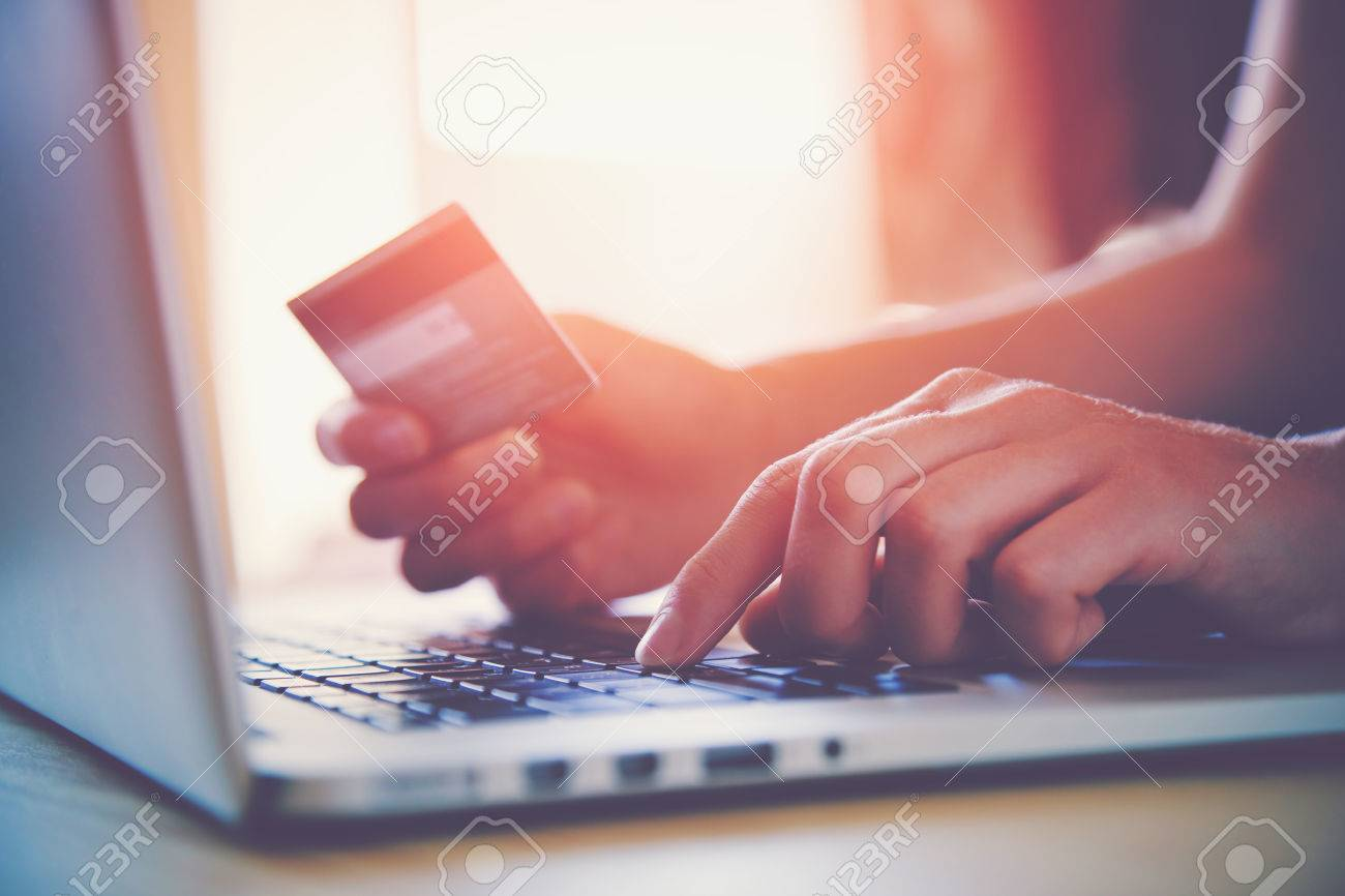 Hands holding credit card and using laptop. Online shopping Stock Photo - 46650892