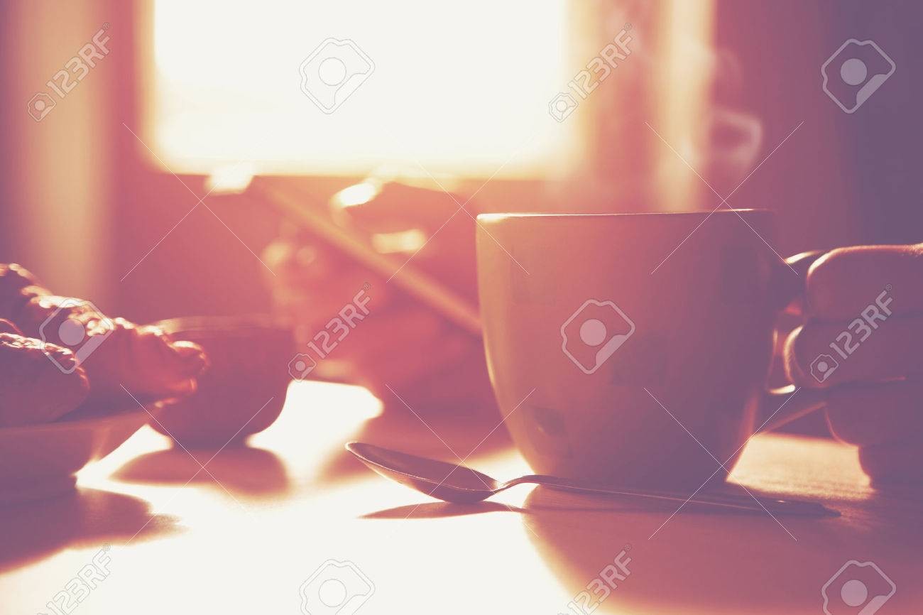 fresh breakfast with hot coffee and browsing smartphone in morning sunlight Stock Photo - 46650906