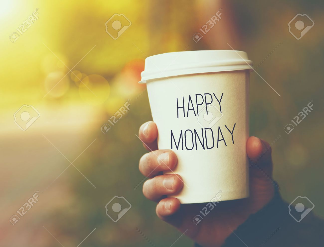Hand holding paper cup of coffee with happy monday motivational hand holding paper cup of coffee with happy monday motivational text on natural morning background voltagebd Gallery