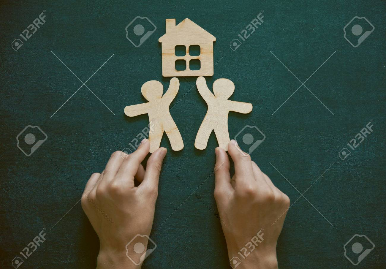 Hands holding little wooden men and house on blackboard background hands holding little wooden men and house on blackboard background symbol of construction sweet buycottarizona Image collections