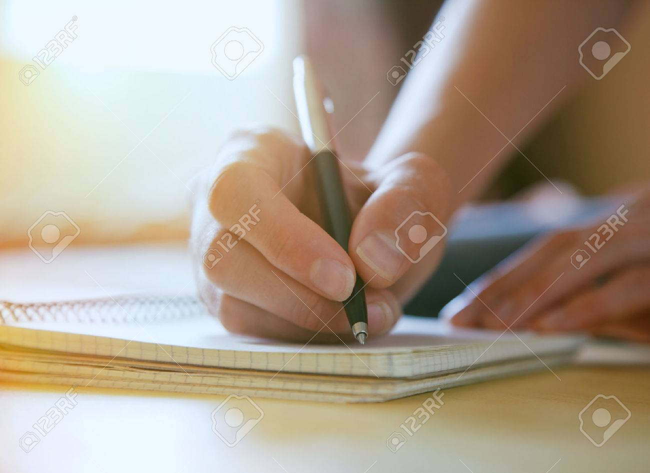 female hands with pen writing on notebook Stock Photo - 46650599