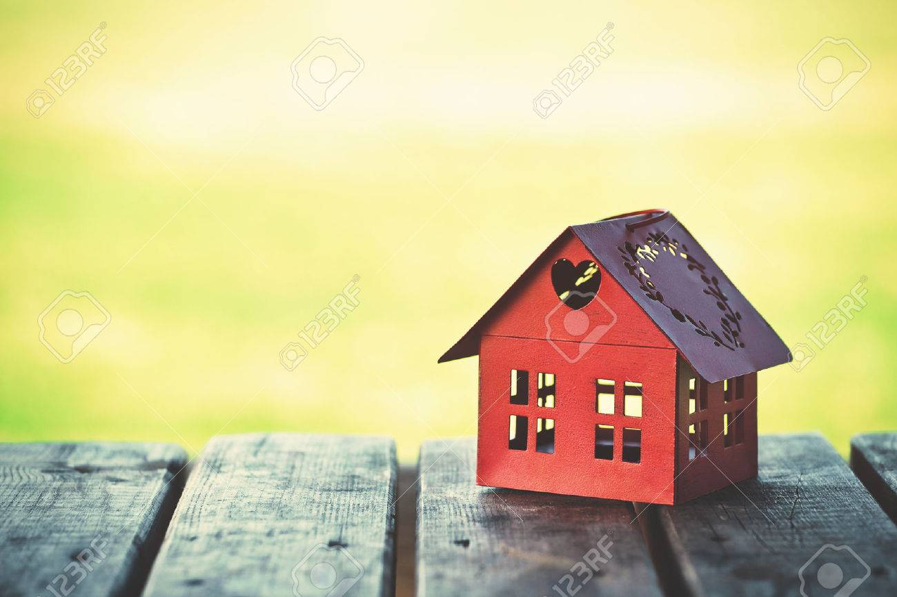 red model of house as symbol on sunny background Stock Photo - 46649741