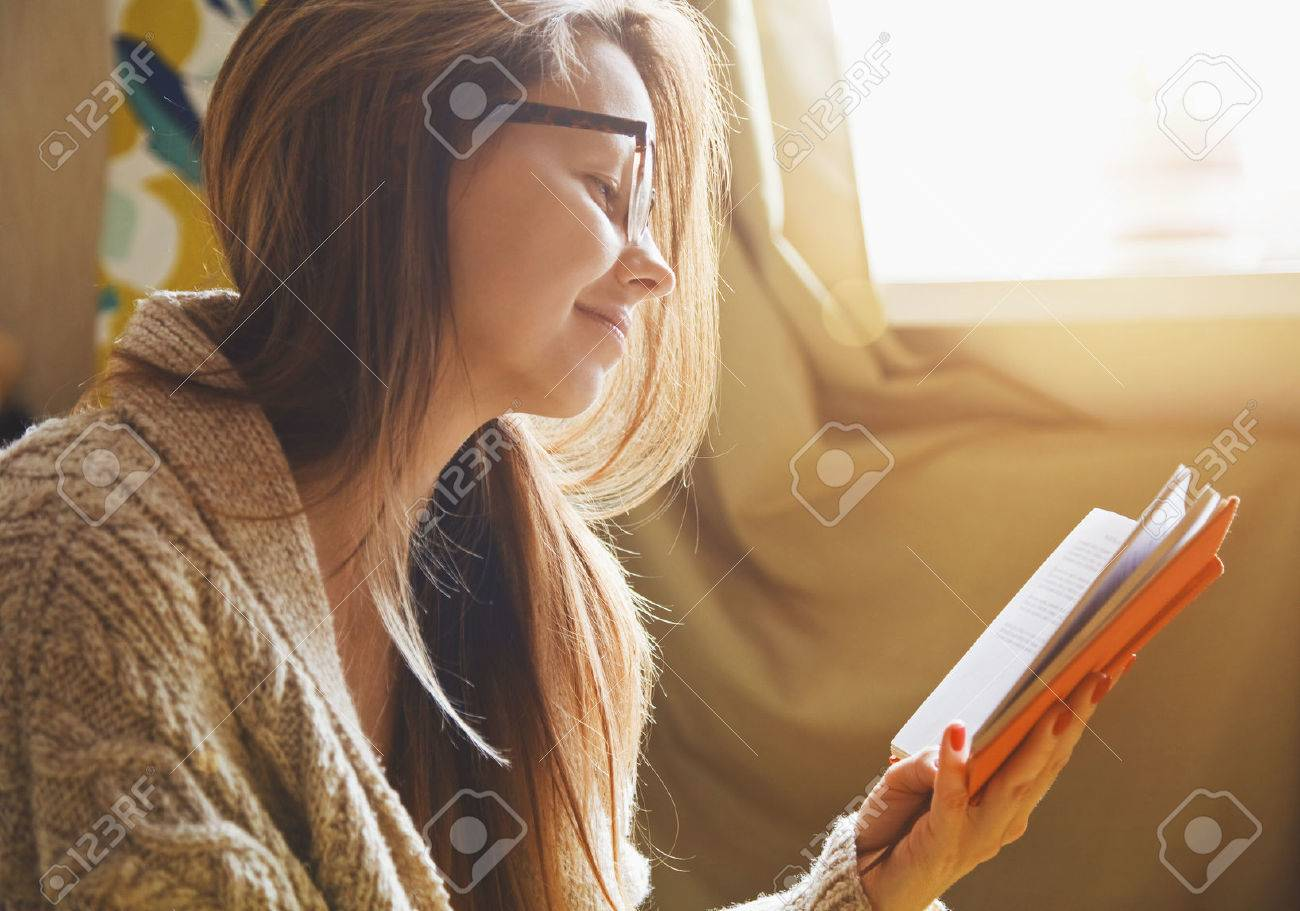 girl reading book at home in morning sunlight Stock Photo - 47461050