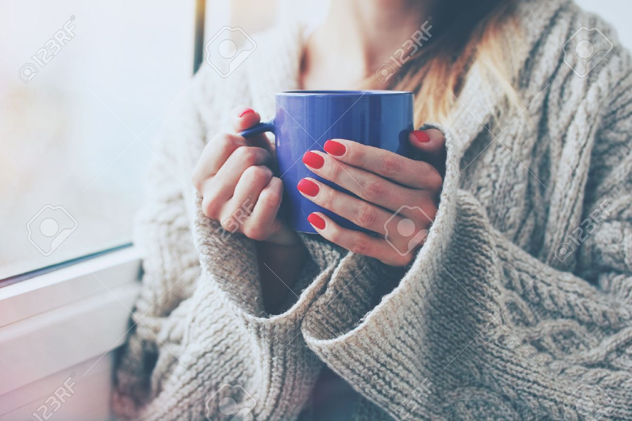 hands holding hot cup of coffee or tea in morning Stock Photo - 47462647