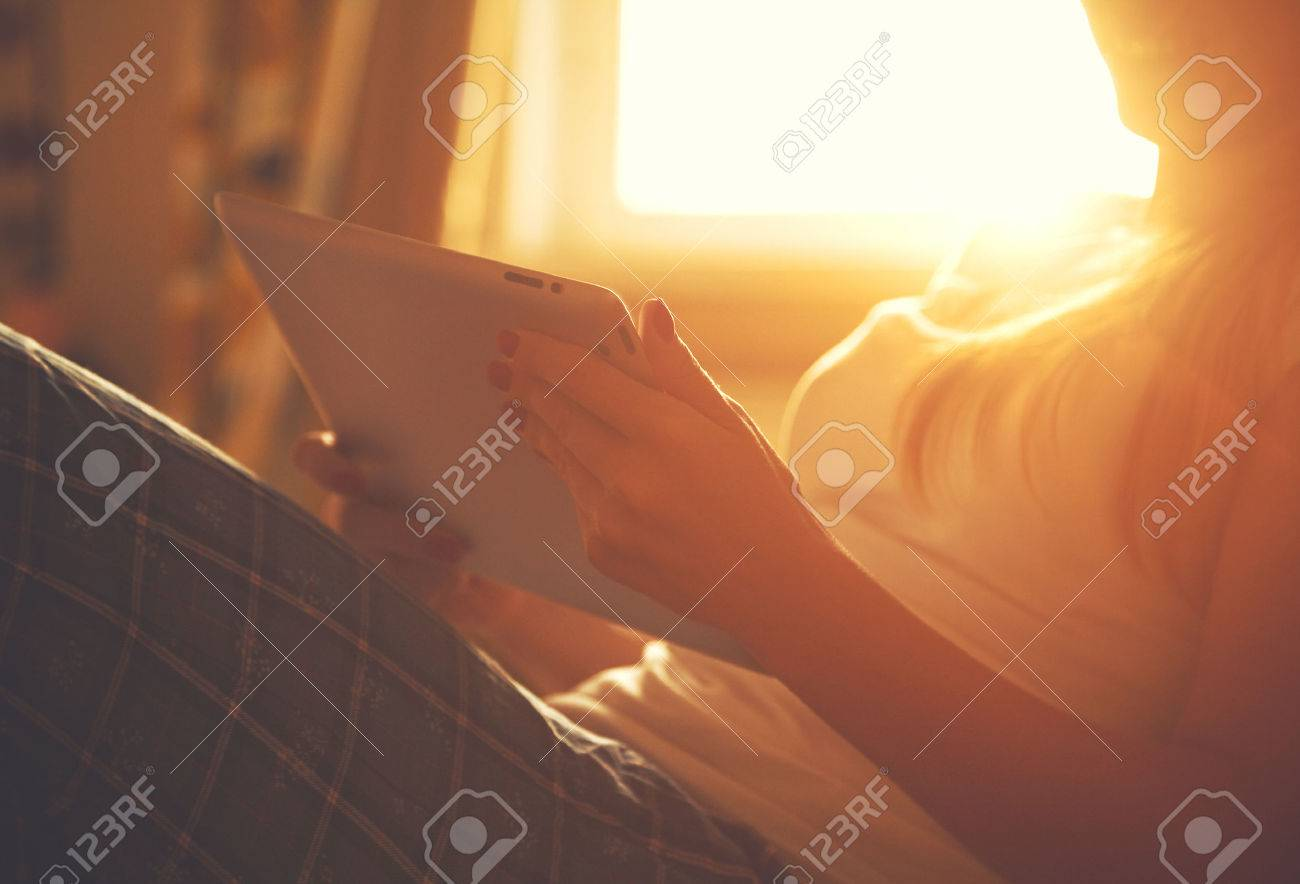 hands holding digital tablet pc and touching with finger in sunlight Stock Photo - 46806338