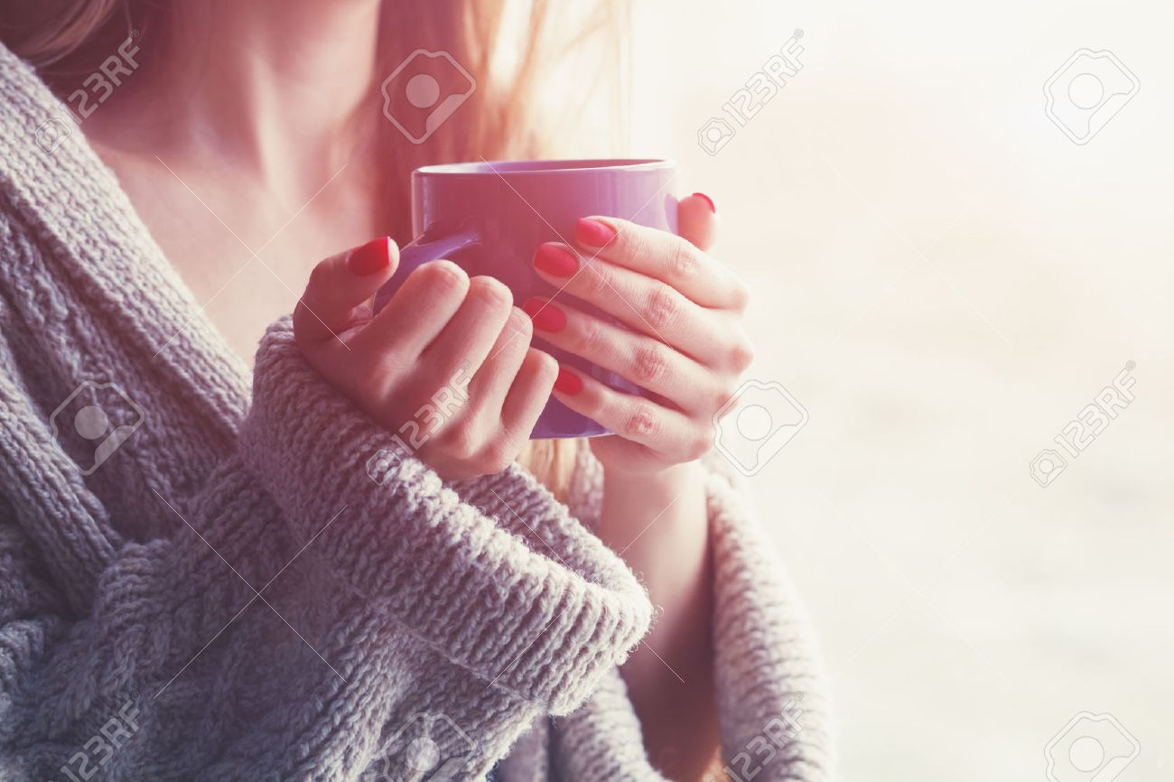 hands holding hot cup of coffee or tea in morning Stock Photo - 57077238