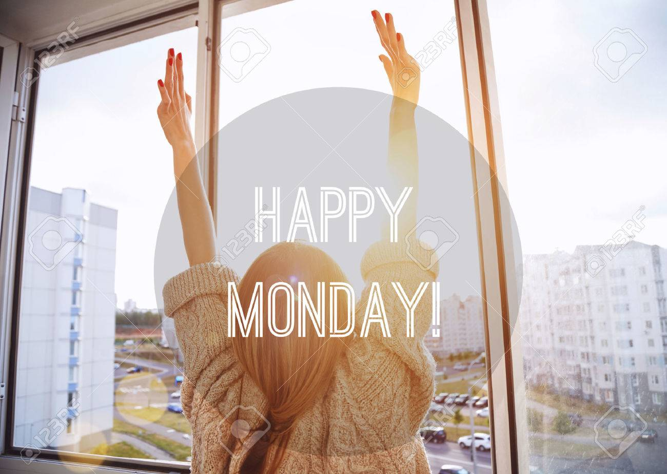 Woman facing the sunrise with raising hands. Happy Monday motivational text Stock Photo - 57077245