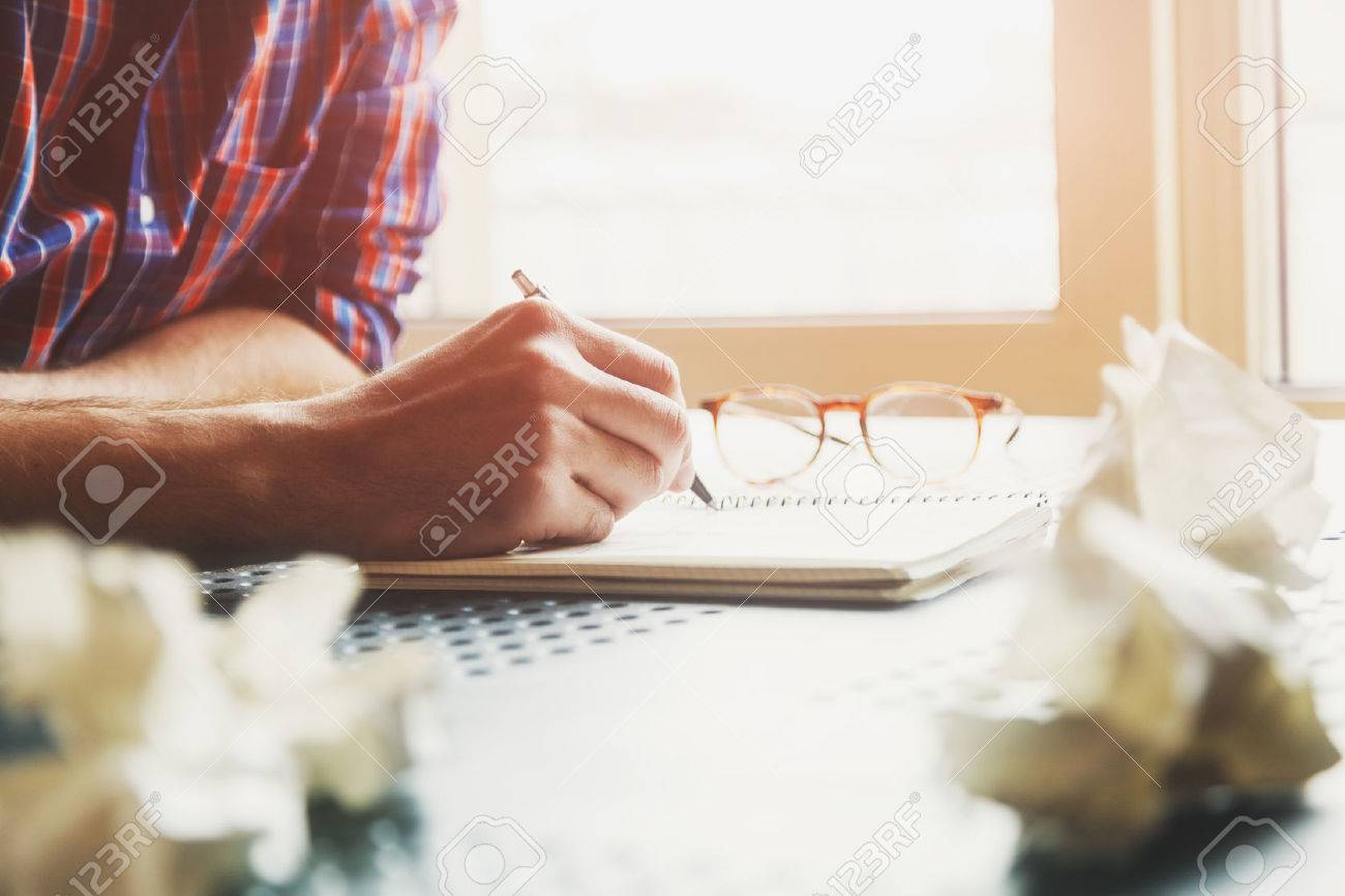 hand writing in notebook with pen and paper balls Stock Photo - 57106146