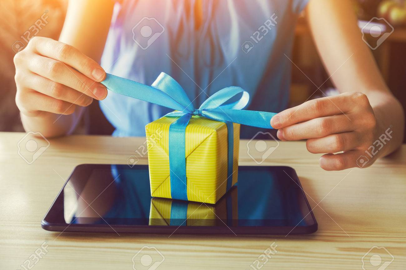 hands with gift box and digital tablet. online shopping concept - 64921011