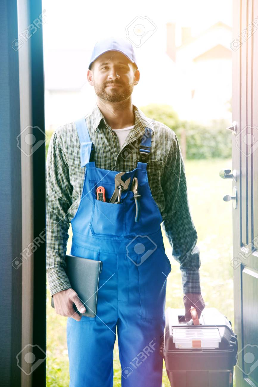 Portrait of handsome worker, service man, plumber or electric - 83918046