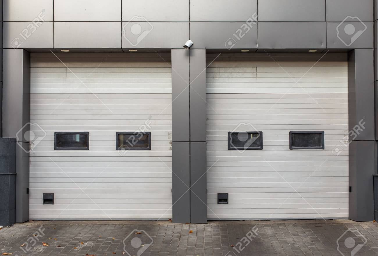 Two White Garage Doors Sectional Lift Gates Stock Photo Picture