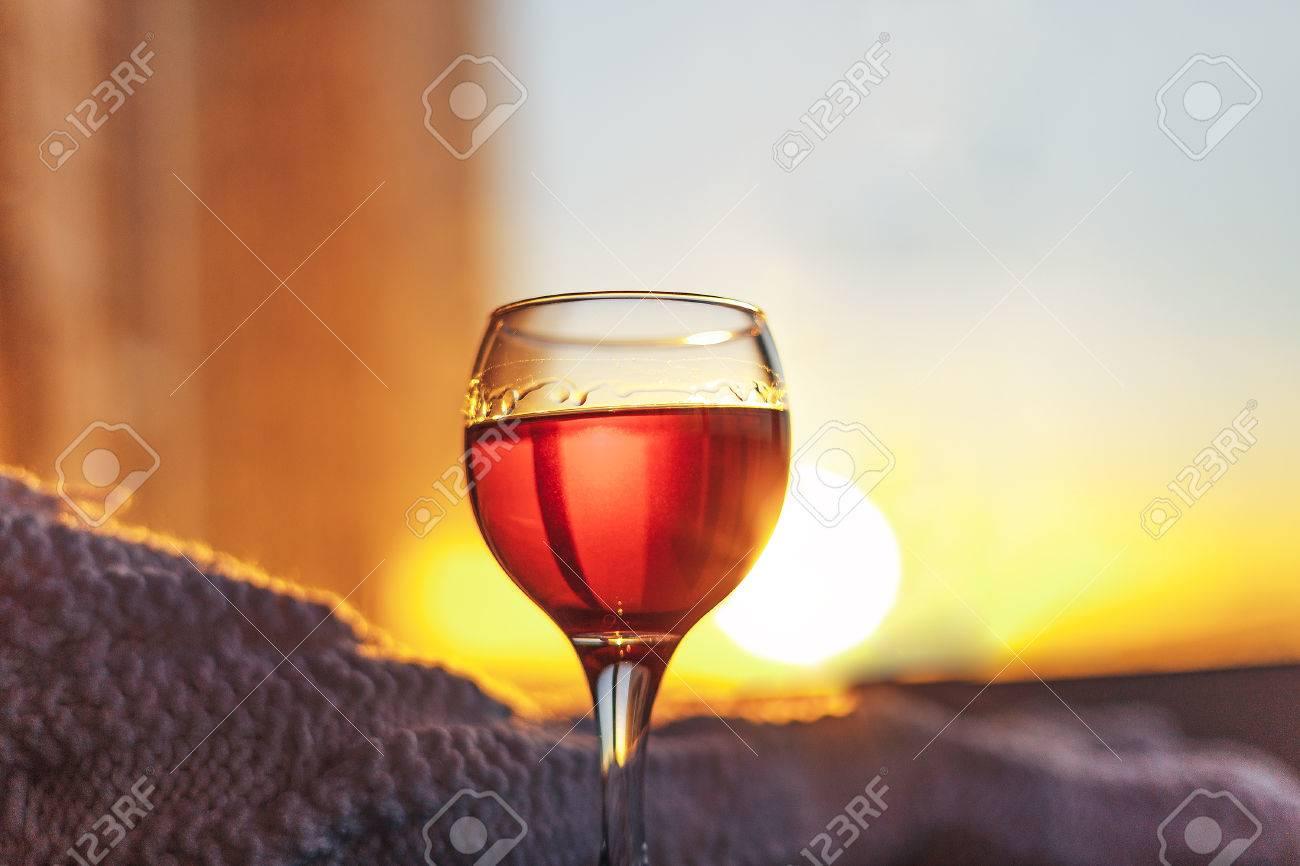 Red wine and white blanket sunny evening lights toned bokeh image stock  photo jpg 1300x866 Wine 99e415199