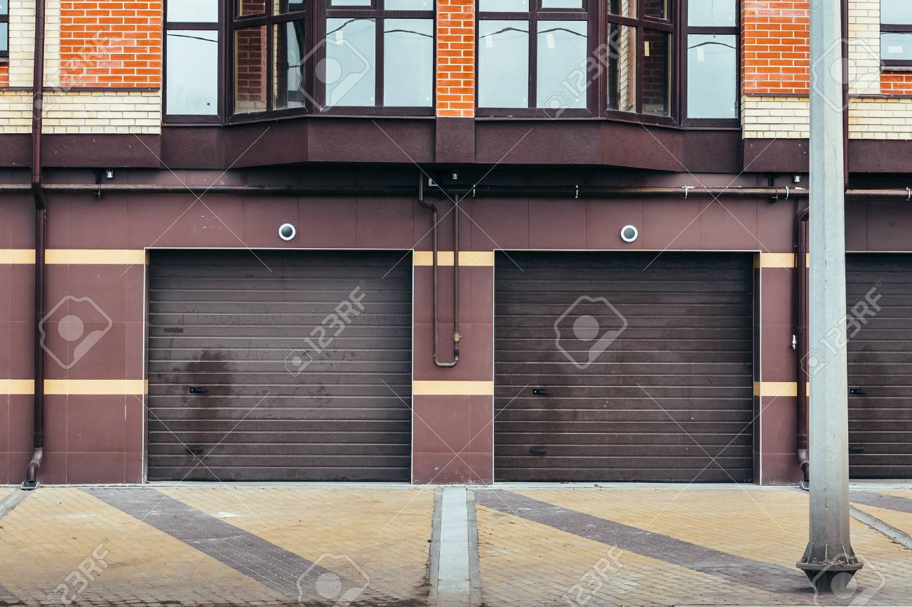Brown Garage Doors For Car Parking In Residential House Sectional