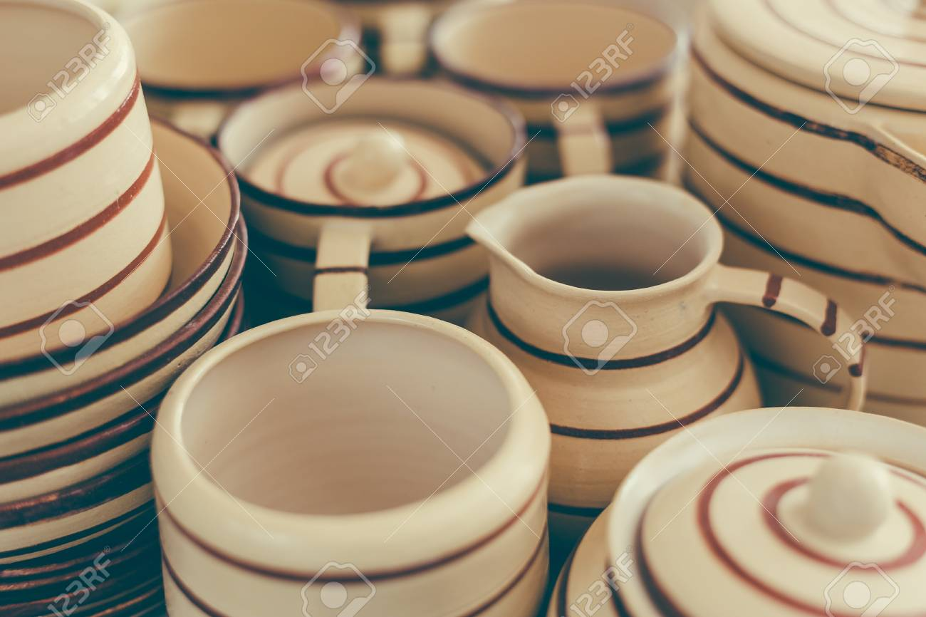 Handcrafted pottery set of dishes handmade Utensils background selective focus toned Stock Photo & Handcrafted Pottery Set Of Dishes Handmade Utensils Background ...