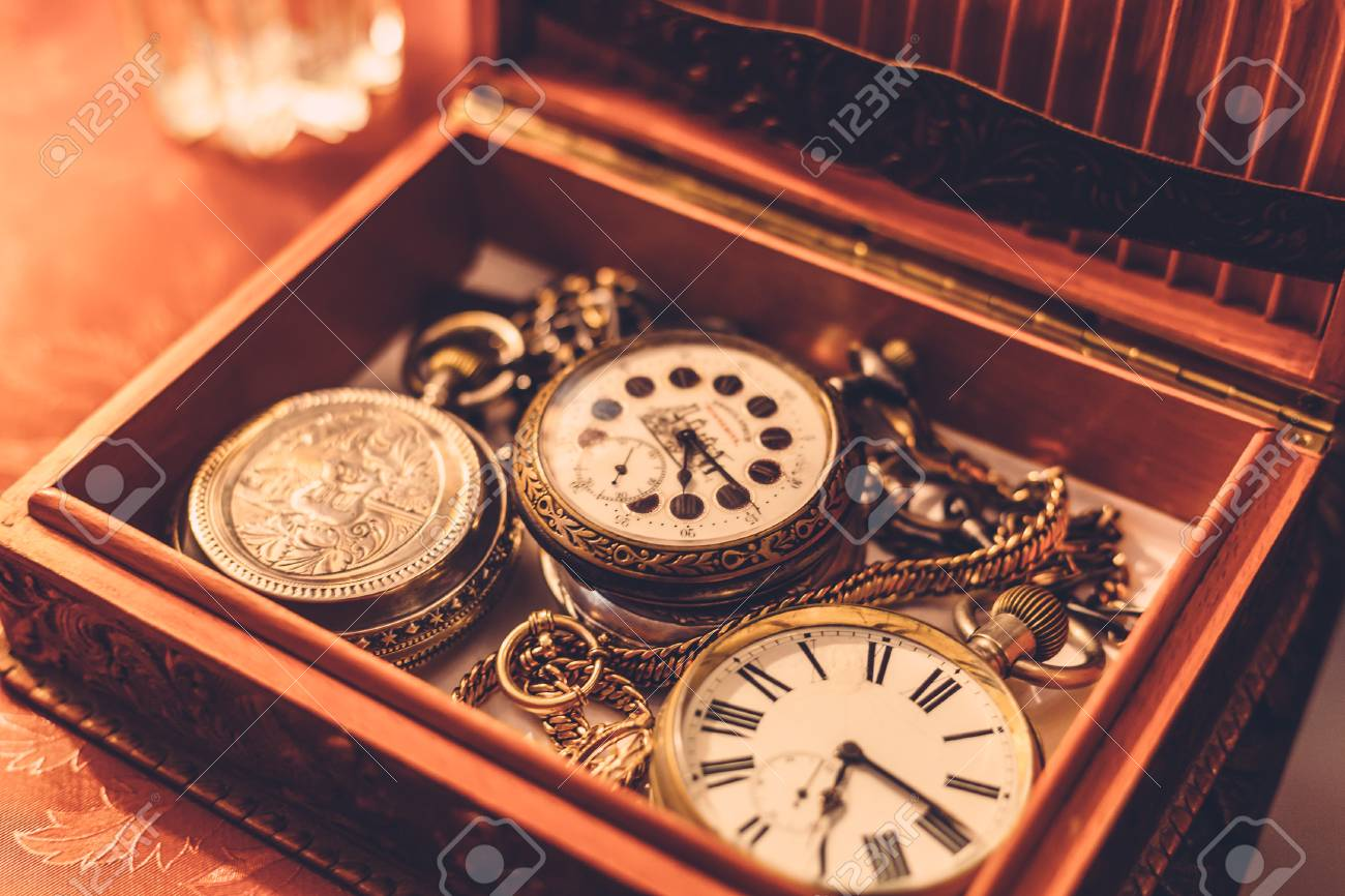 1c29bde64 Ancient vintage pocket watch or clock in a wooden box, toned Stock Photo -  89135265