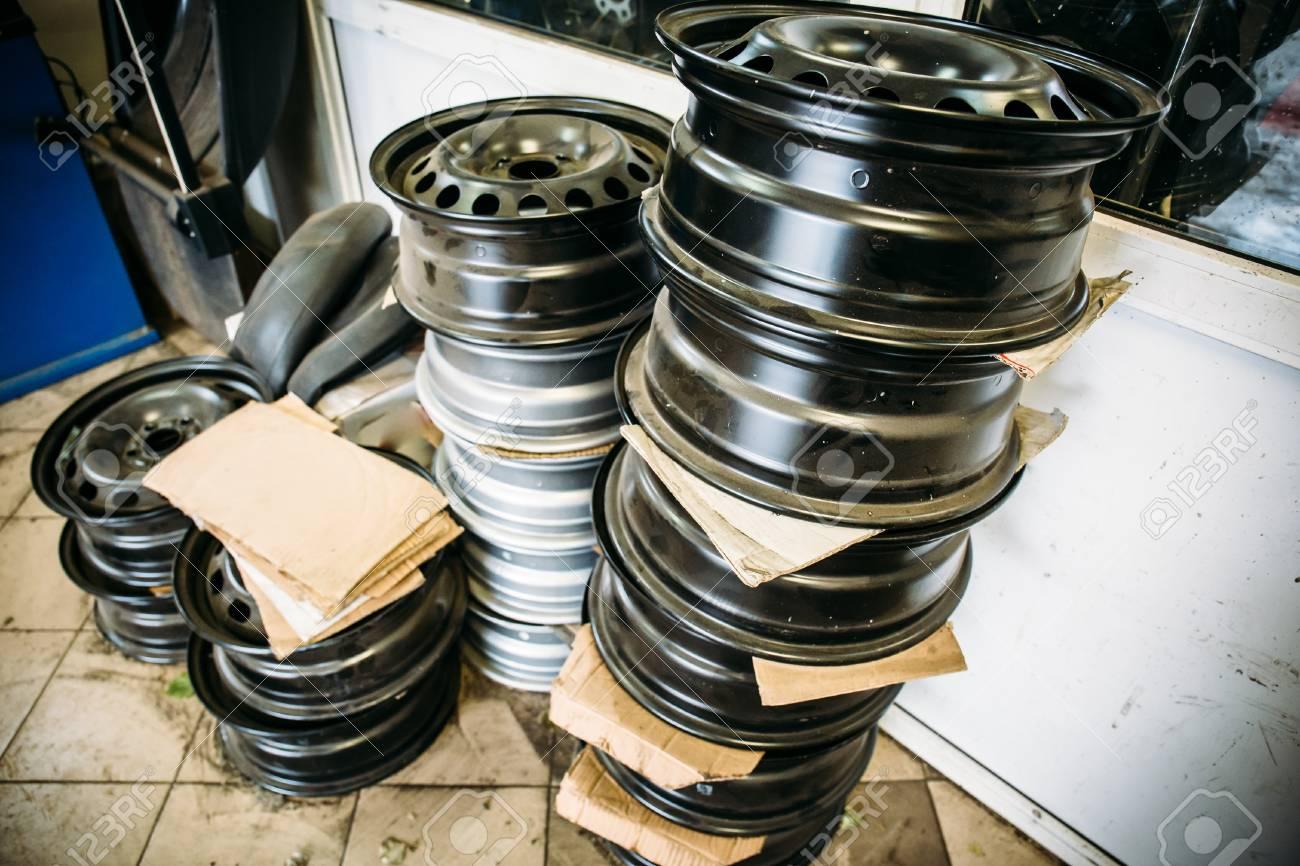 Group of car wheels in garage service repair shop, steel automobile