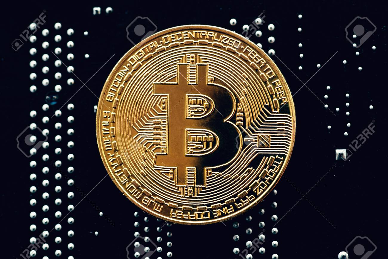 Cryptocurrency Golden Bitcoin Coin On Printed Circuit Board ...