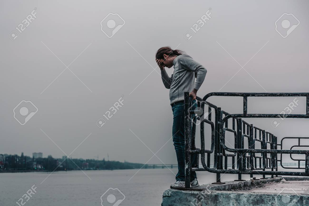 Depressed man is going to jump from bridge  Suicide concept,