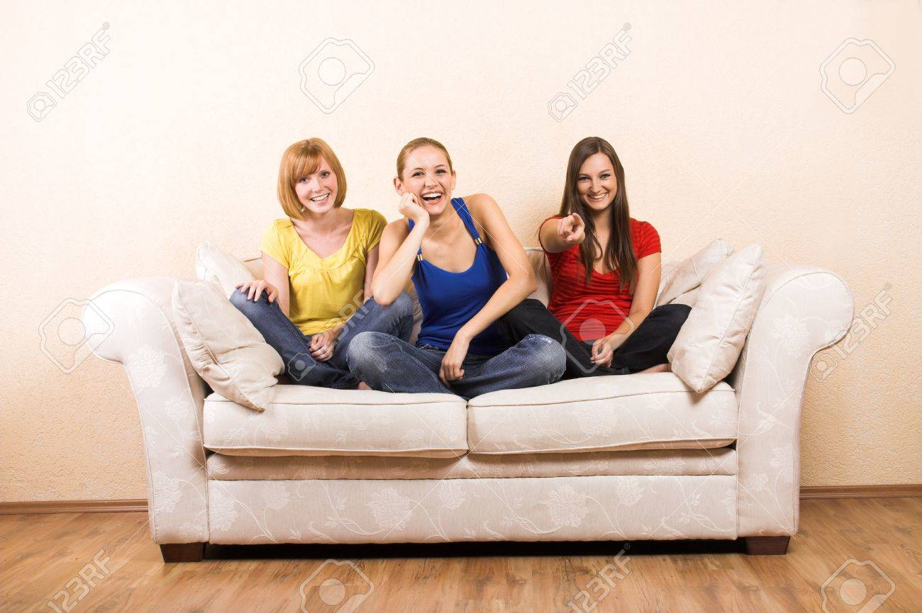 Three young beautiful women are laughing on a lounge Stock Photo - 5018218