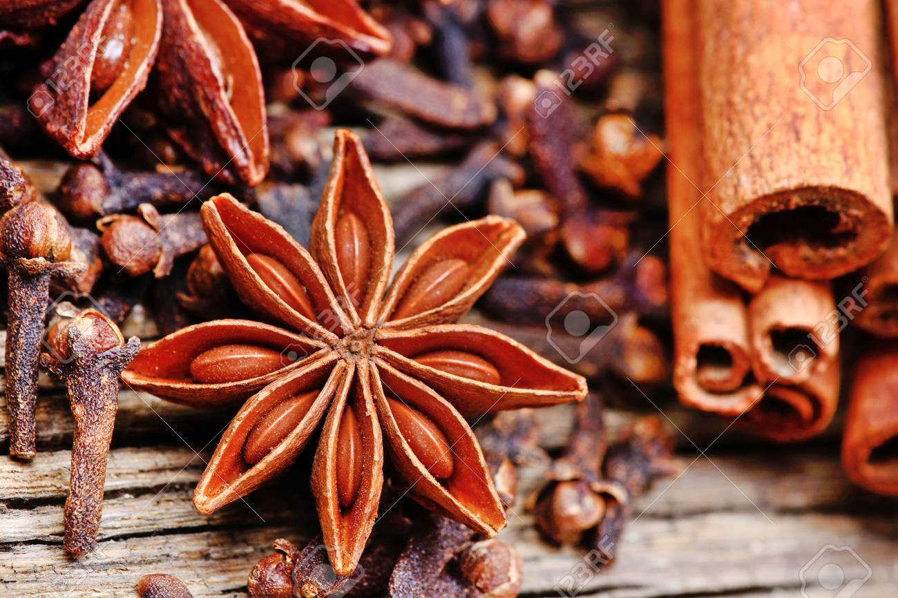 Anise Star With Cloves And Cinnamon Sticks On Rustic Wooden Table