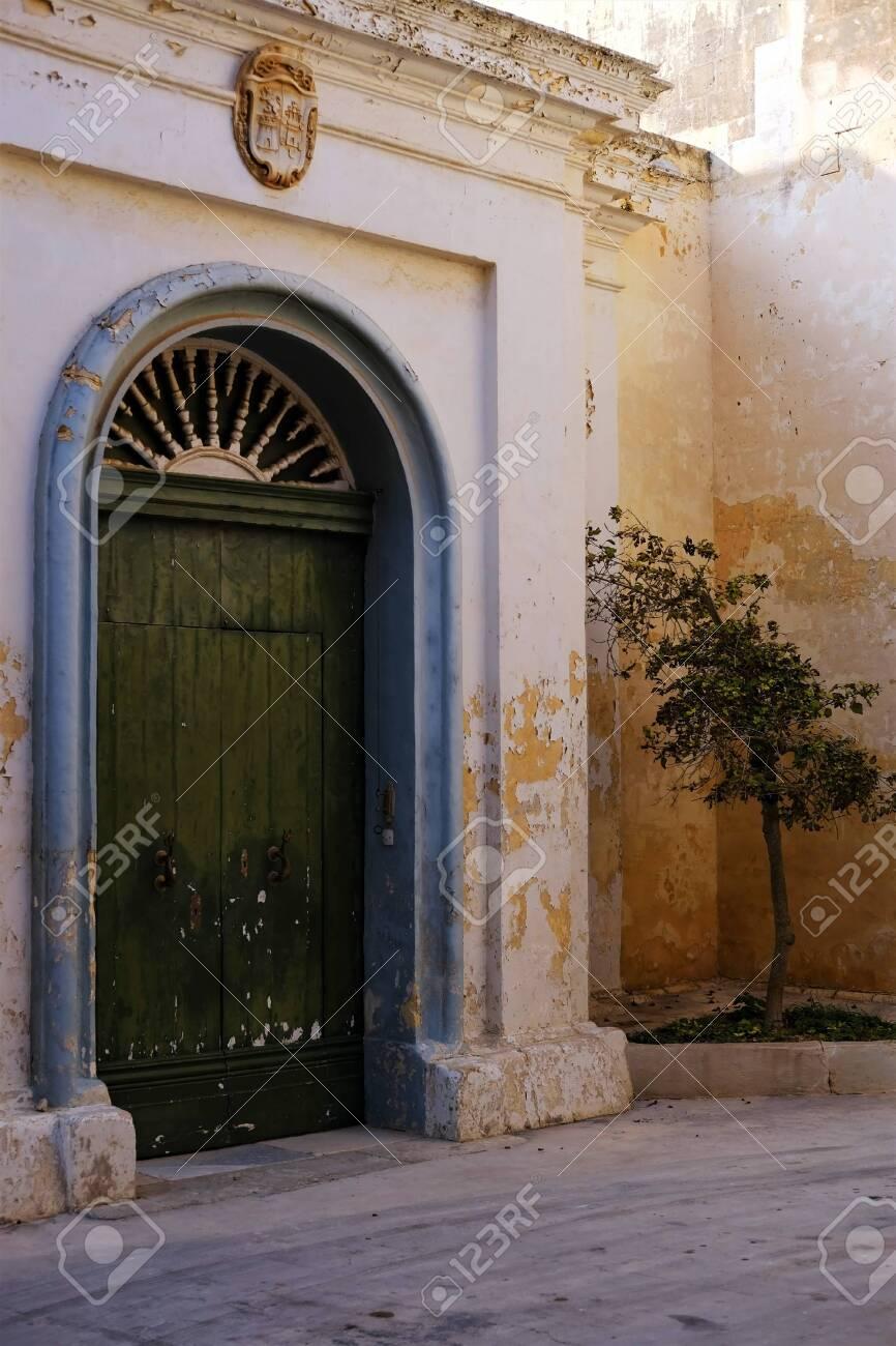 green door in a quiet cul-de-sac in Mdina, Malta - 140181199