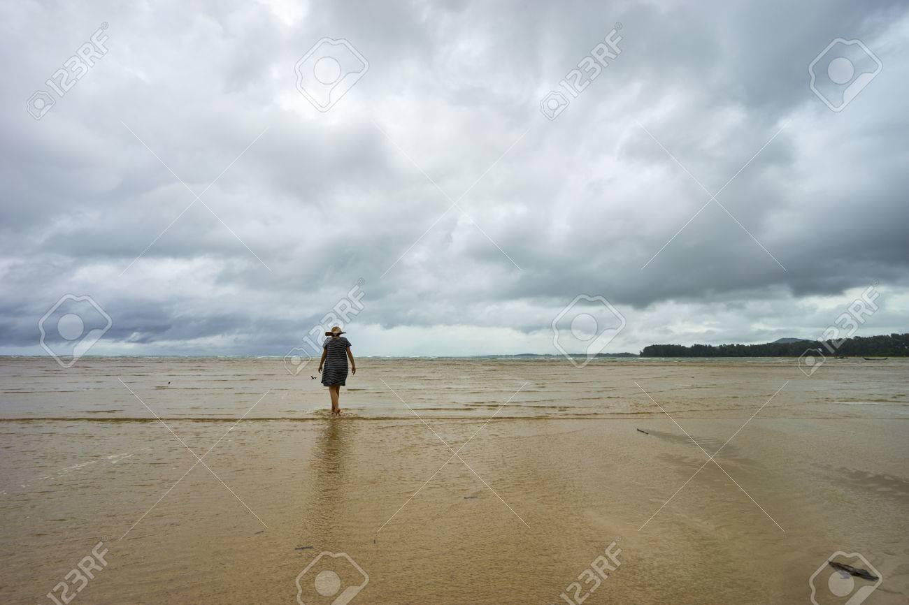 Beautiful alone girl siluet on the beach stock photo 83760620