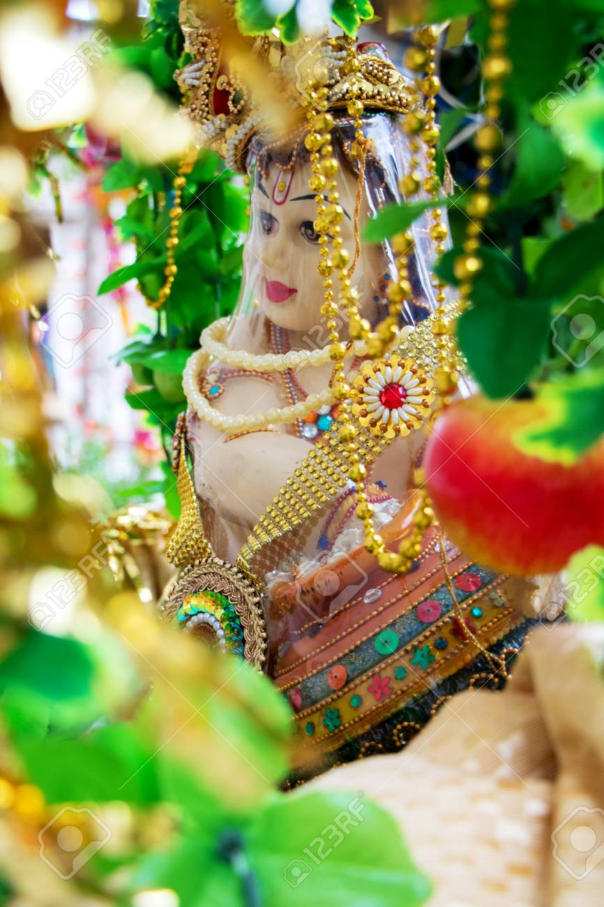 The Hindu God, Lord Krishna, in his childhood form, eating butter