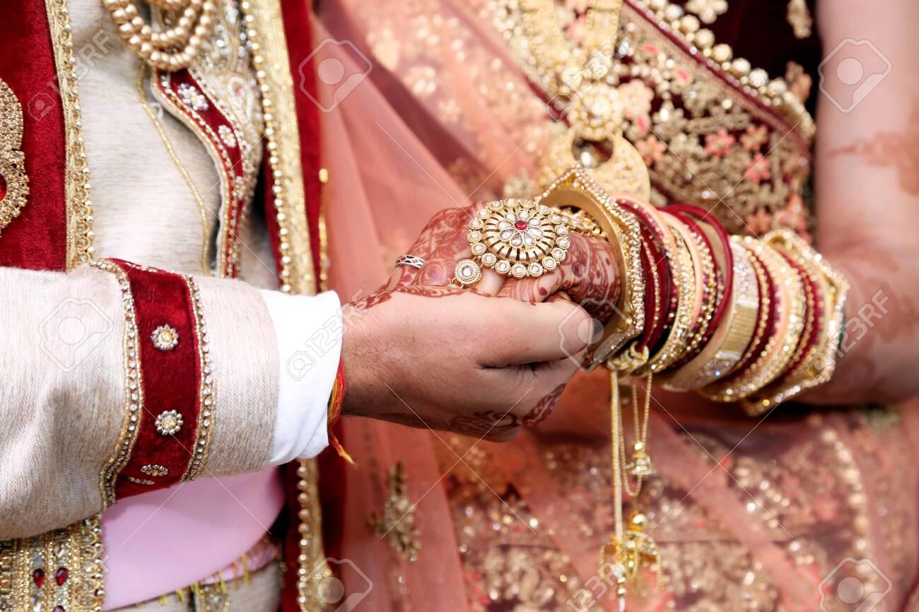 138196692 bride groom hand s together in indian wedding