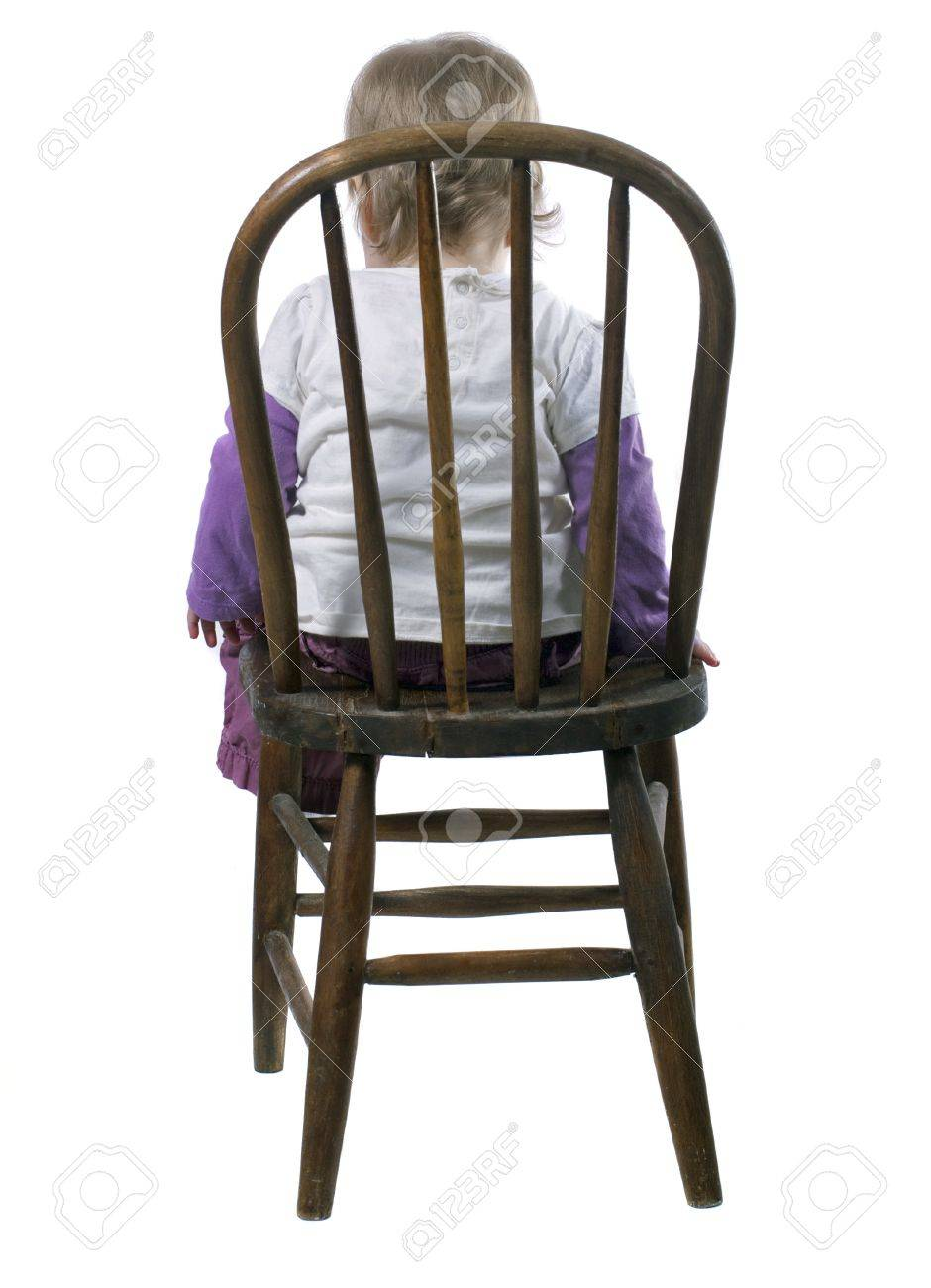 Little Girl Sitting In A Time Out Chair Stock Photo Picture And