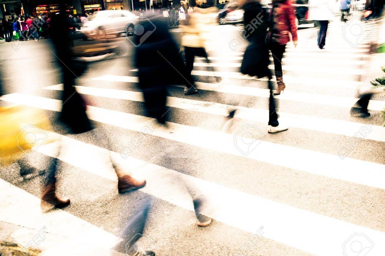 Busy big city street people on zebra crossing Stock Photo - 11624777