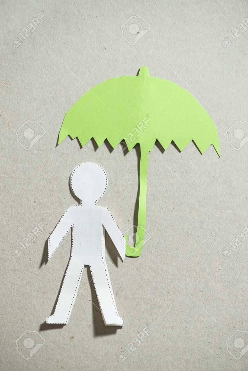 Fugire Of Men And Umbrella Cutout Paper Stock Photo