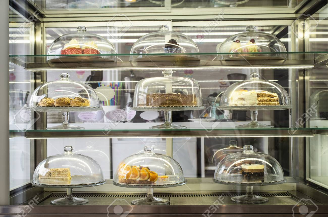 Pastries And Cakes On Showcase In The Pastry Shop Glass Lid Standard Bild