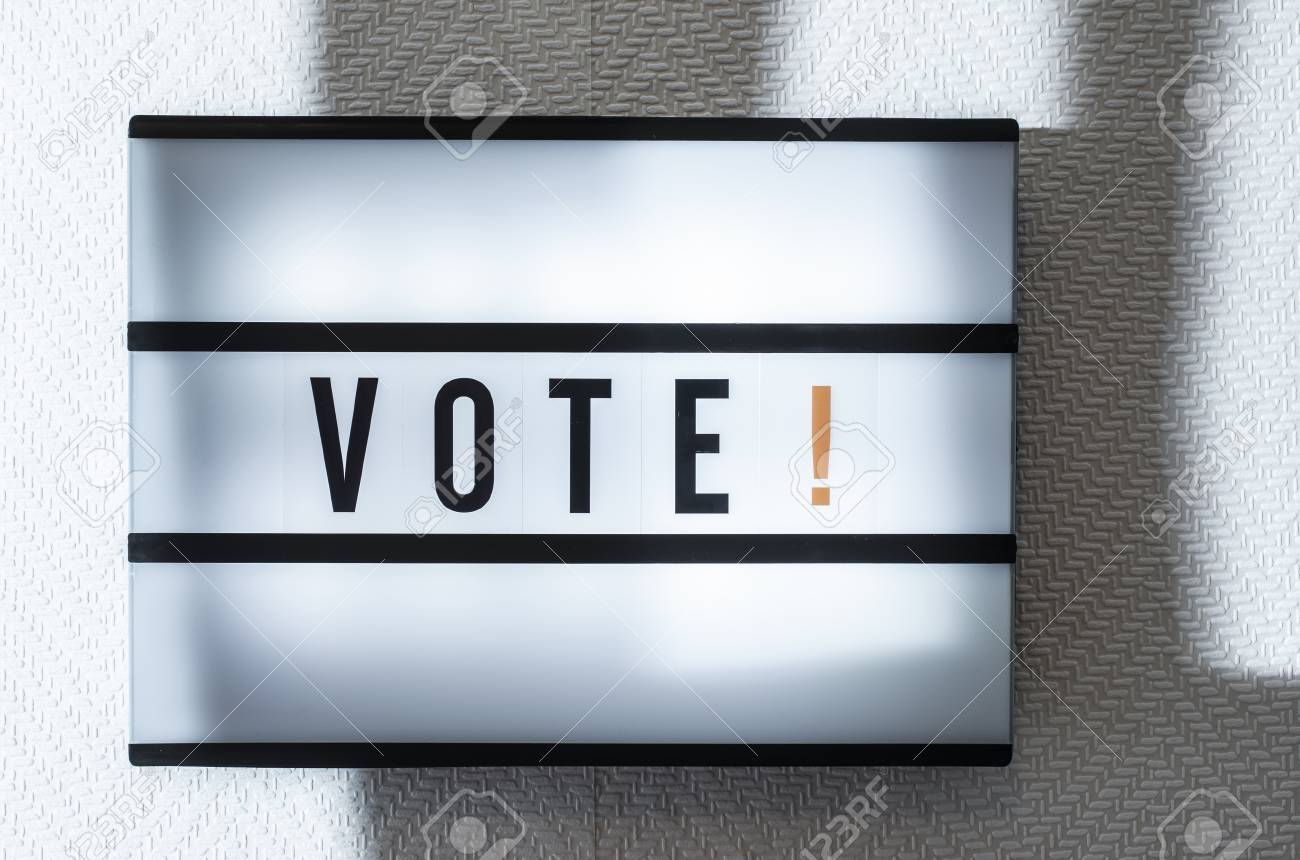 Message Vote on illuminated board  Voting concept with text