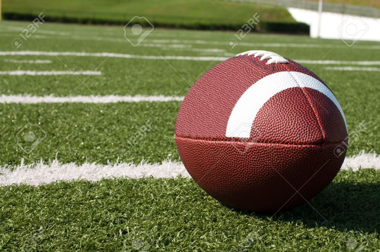 Closeup of American football on field with yard lines. Stock Photo - 7625437